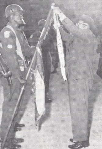 A South Korean streamer is added to the Ethiopian flag in 1953. This photo shows the Lion of Judah shield patch worn by officers on dress occasions, above the United Nations sleeve emblem.