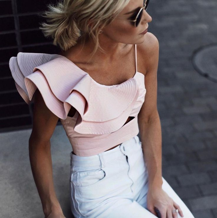 Pretty pale pink ruffled top with white pants.