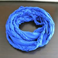This is the product of two different t-shirts scarf tutorial.  The first was a DIY BRAIDED  scarf that I did a while back based on a German scarf. I had pla...