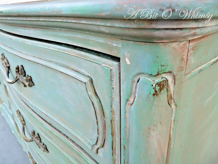 Provence and Antibes Green (not mixed as one color, see her tutorial on how she did the technique) Annie Sloan Chalk Paint over gold paint on French dresser, waxed and distressed. by Jenine at A Bit of Whimsy. She calls this her Verdigris finish.