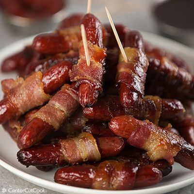 Little Smokies get wrapped in bacon then sprinkled with brown sugar and baked until the bacon is crispy! Served with spicy ketchup on the side, these Bacon Wrapped Little Smokies are perfect for entertaining!
