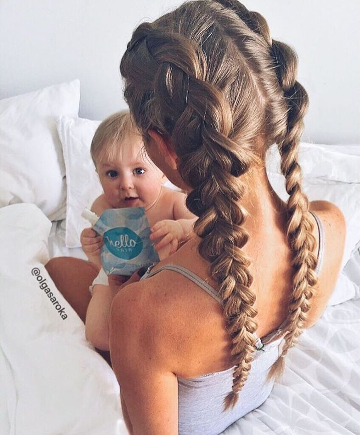 A beautiful dutch braid pigtail hairstyle that is cute and practical for a busy day.  Do this easy hairdo Click here to see more hairstyles http://www.amodernmomblog.com/2016/09/quick-hairstyles/