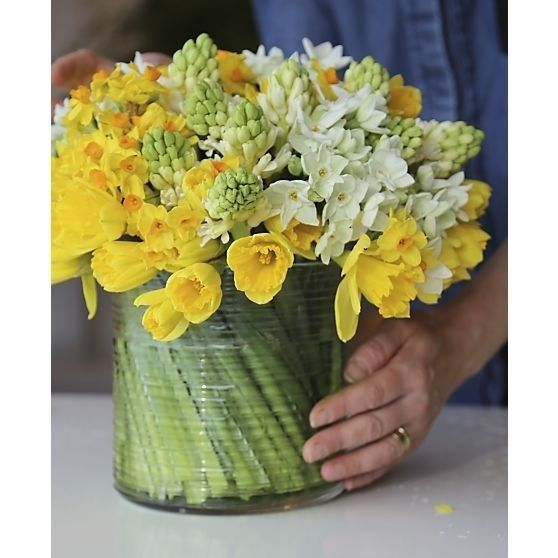 Wide vases are pretty, but maneuvering flowers in them can be tricky. Well, not until you try spiraling your stems. | 14 Floral Arrangement Hacks That Are Simply Divine