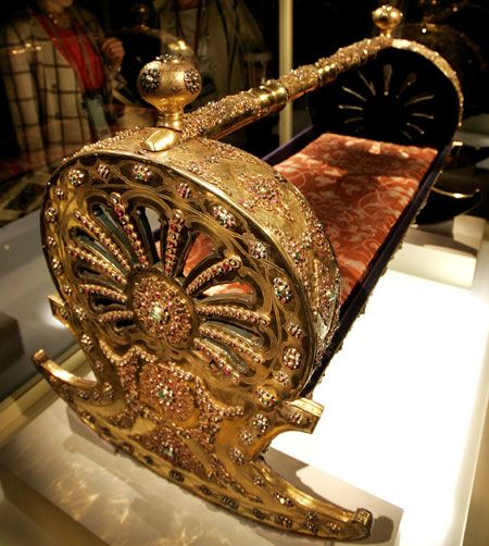 Ruby Luxist, 18th century baby's cradle. Covered in gold and set with more than 2,000 gems including diamonds, rubies, and emeralds, it's currently on display in Tokyo at a special exhibit that includes about 140 other antique treasures from the Ottoman Empire (which came before the Republic of Turkey).