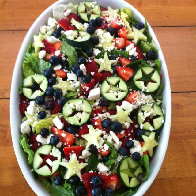My 4th of July Salad fresh romaine lettuce, blueberries, strawberries cut in small chunks, cucumber stars (cut outs done with cookie cutter) and Feta cheese. Served with Marie's poppyseed dressing. #redwhiteandblue #4thofjuly #redwhiteandbluesalad