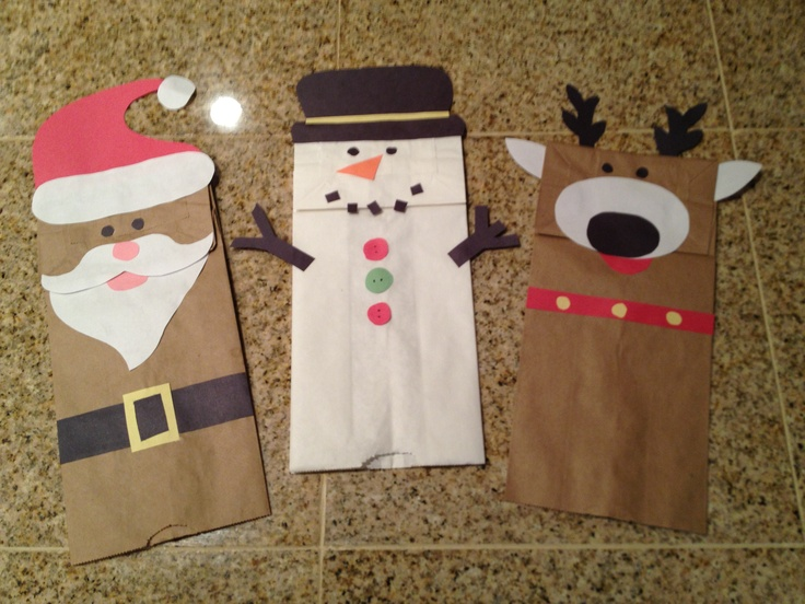 Christmas craft. Paper bag hand puppets. Easy and cheap. Construction paper and glue. Christmas. Craft. Kids. Santa. Snowman. Reindeer.