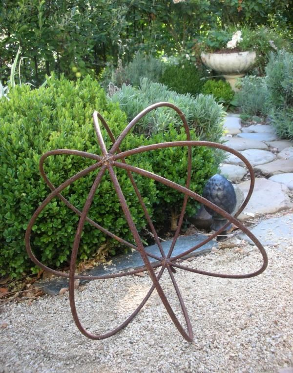 Metal Orb Makes A Striking Garden Feature