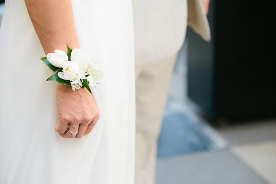 tulips and hydrangea in a clean, white wrist corsage