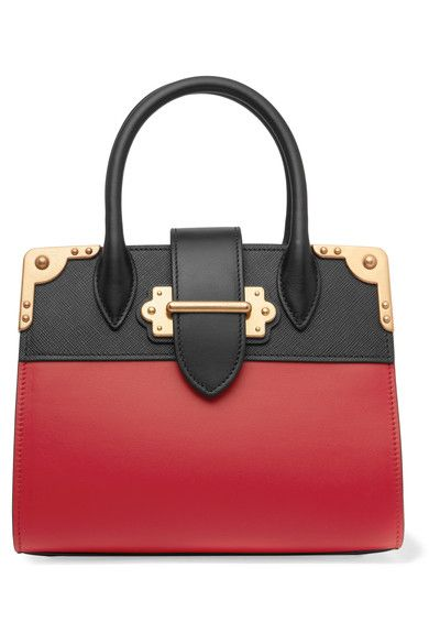 Red leather, black textured-leather (Calf) Tab-fastening front flap Weighs approximately 2.2lbs/ 1kg Made in Italy
