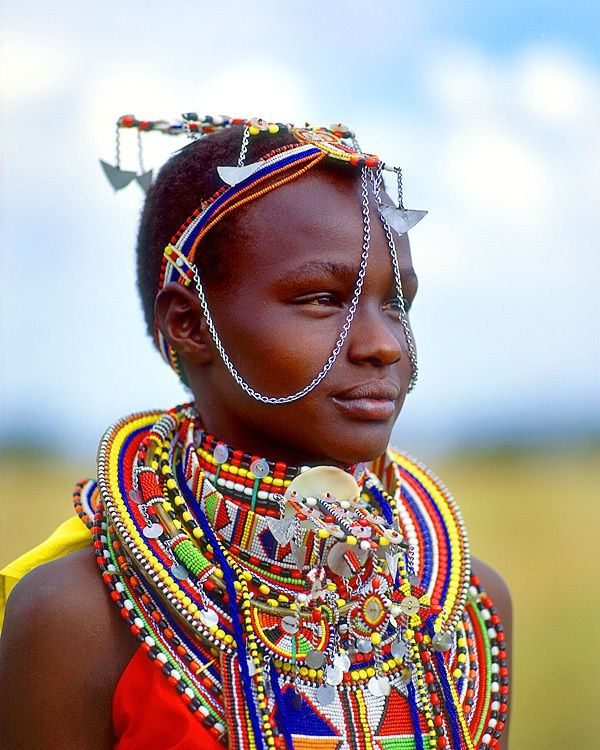 Maasai girl, Maasai Mara National Park, Kenya   by Jim Zuckerman