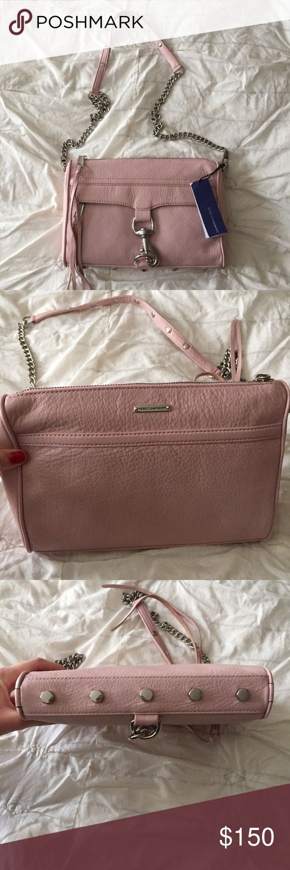 "Rebecca Minkoff Bag NWT Rebecca Minkoff M.A.C. crossbody bag. Roomy but compact. Light pink with silver hardware. 21"" chain strap drop. Genuine leather. Bag dimensions- 11"" L 8"" H 2"" D. Interior pockets and hidden exterior zip pocket underneath front flap. Beautiful bag that retails $295. No trades. Rebecca Minkoff Bags Crossbody Bags"