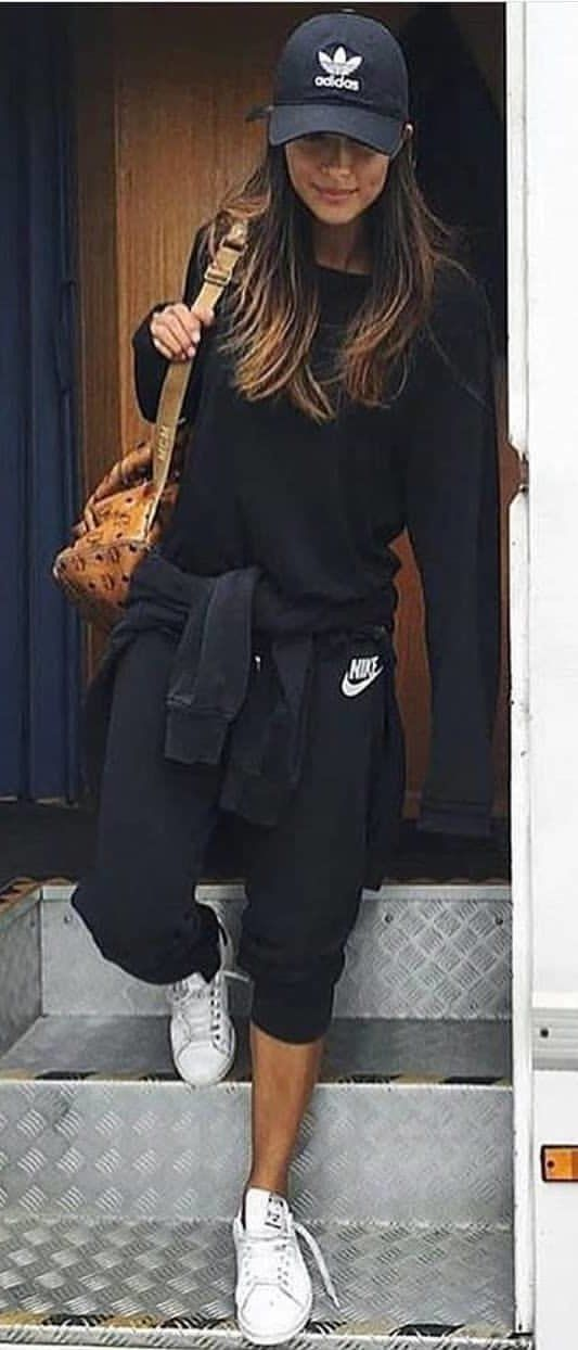 a310f5dca2e7a #spring #outfits woman wearing black Adidas cap and black Nike jugging pants.  Pic by @milano_streetstyle