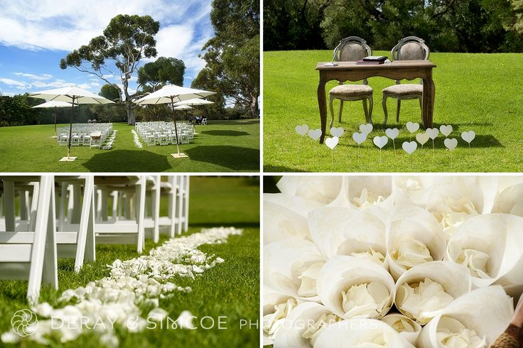 Garden wedding ceremony styling. White hearts, Victorian signing table & chairs and rose petals