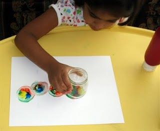 Fun painting activity for kids -- Put paint on the bottom of a jar and spin!