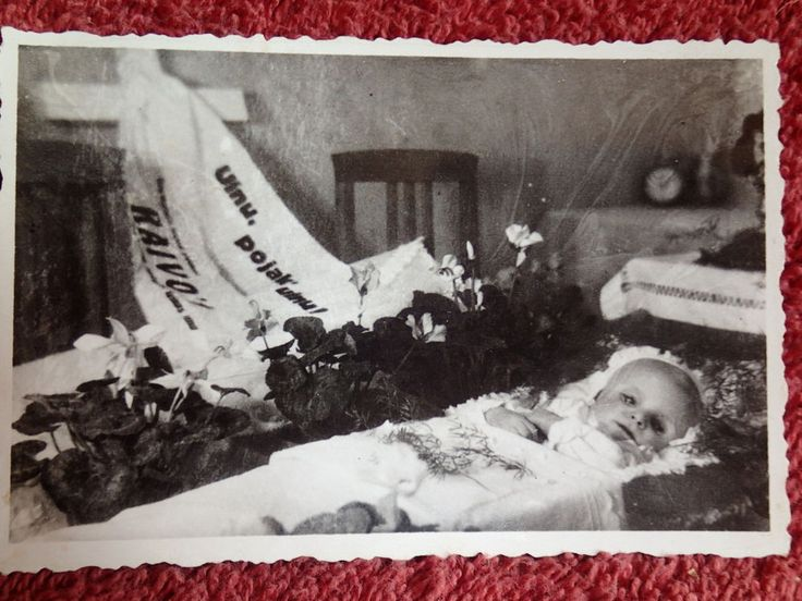 Haunting Post Mortem of a young baby with open eyes.