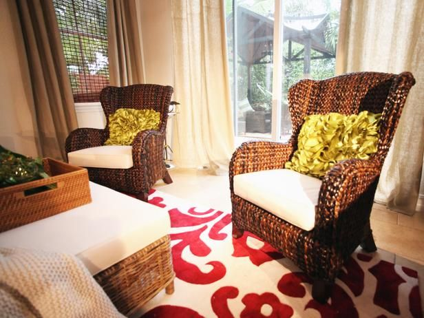 A pair of rattan chairs add a natural element to the for David bromstad bedroom designs