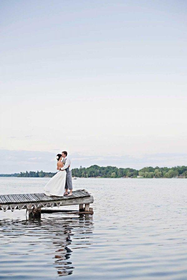 River Wedding. Forehead kiss.