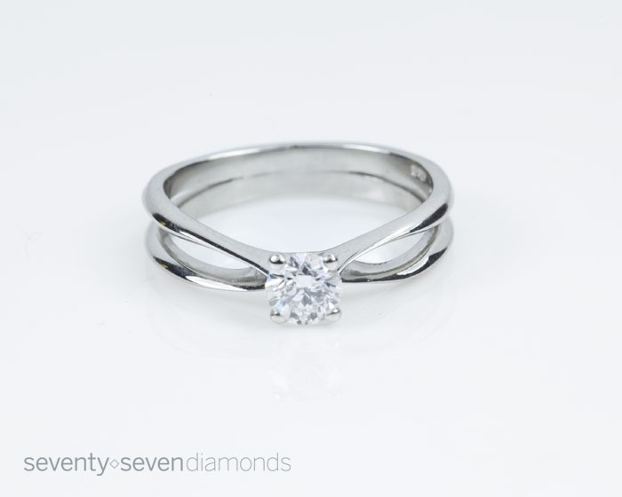 A simple and elegant bespoke engagement ring with unique band design