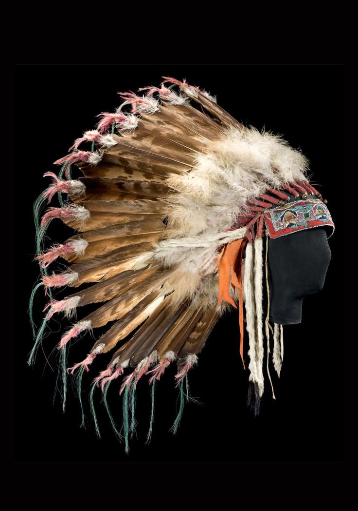 USA | Warrior's headdress; Plains Indians; Crow, Nez Perce (?)  | Bison leather, bear fur, eagle and other feathers, red felt, cloth, glass beads, wool and metal | ca. 1910 | 2'500€ ~  Sold (Dec '13)