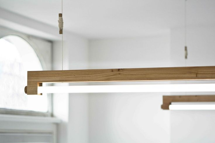 Ninebyfour is a minimalist LED ceiling lamp by the Amsterdam based studio Waarmakers. The LED light tubes do not generate any heat during use, allowing the creators to use atypical materials for the fixture: wood and cork.
