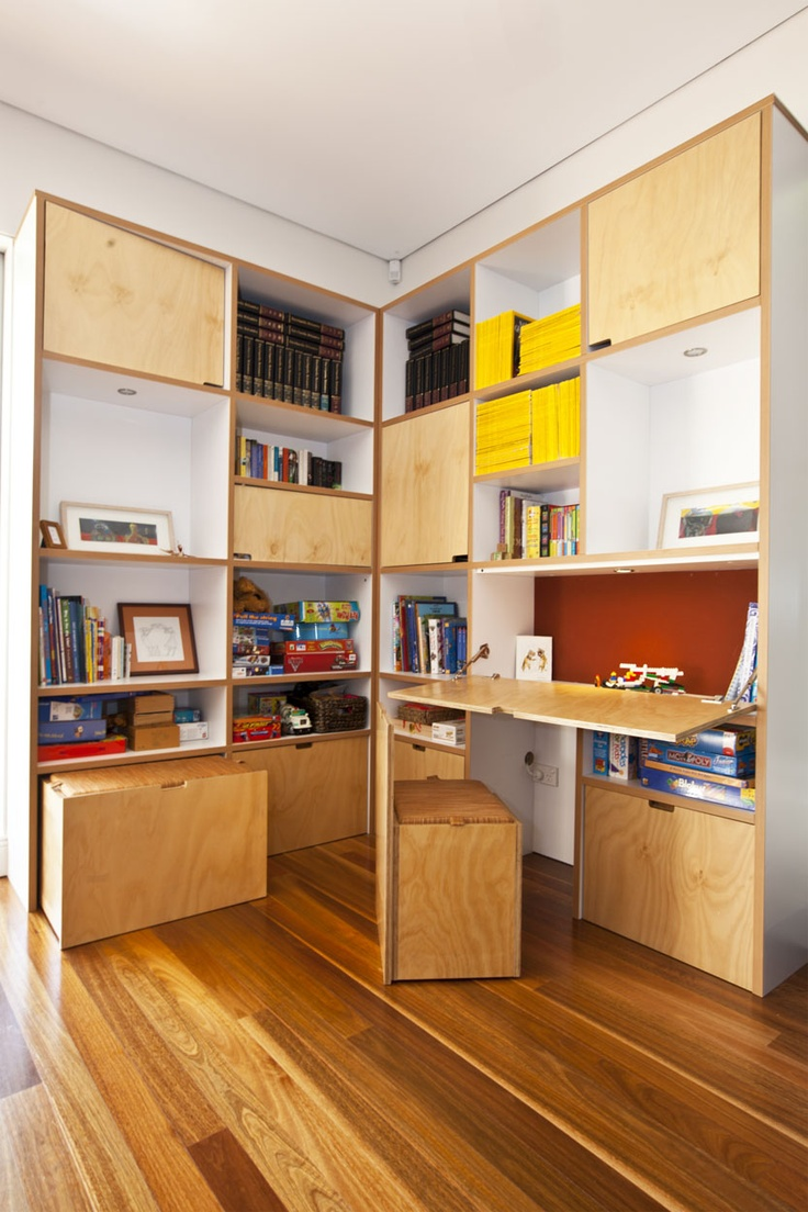 Another corner bookcase with built in desk toy storage