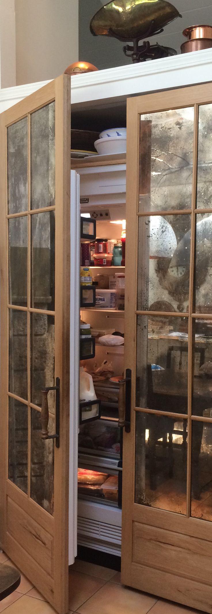 Thermador refrigerator hidden behind custom french doors