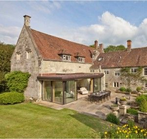 Grade II* Listed building with glass extension Ansty Manor for sale through Knight Frank, glass extension uses IQ's sliding glass doors