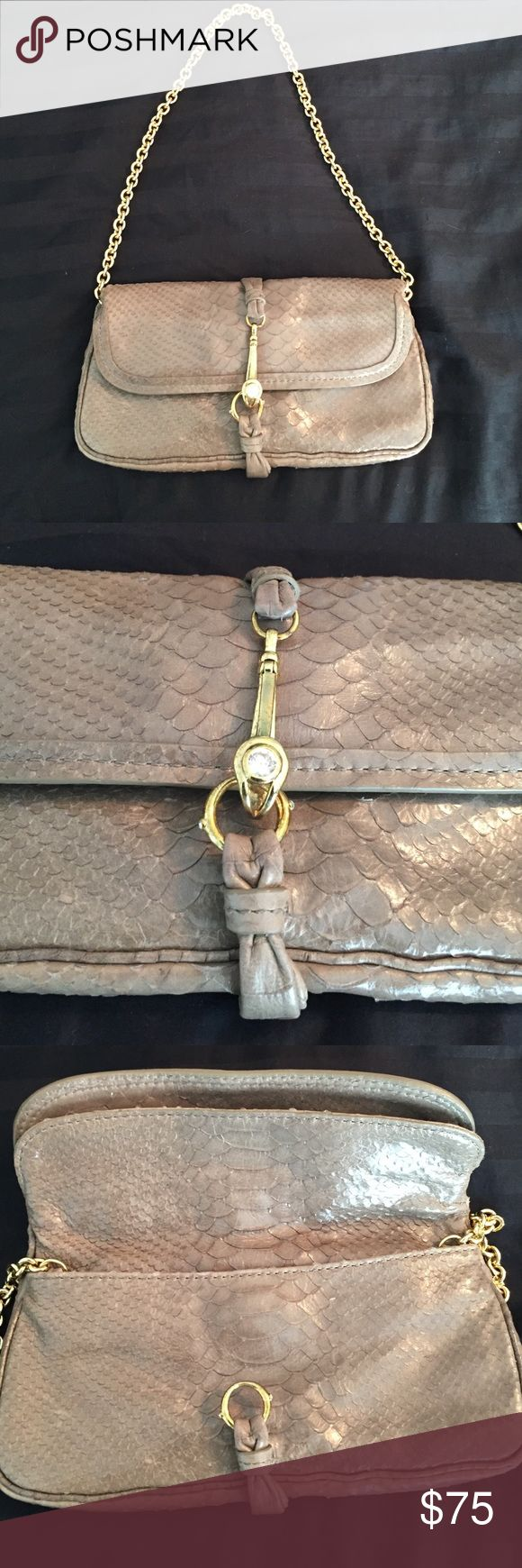Henri Bendel Grey Clutch Henri Bendel bag can be worn as clutch or with gold strap. Has gold and rhinestone hook closure, with two inner compartments and an inner zipper. Taupe grey leather has snakeskin effect - only worn a handful of times, in near brand new condition and comes in original duster bag! henri bendel Bags Clutches & Wristlets