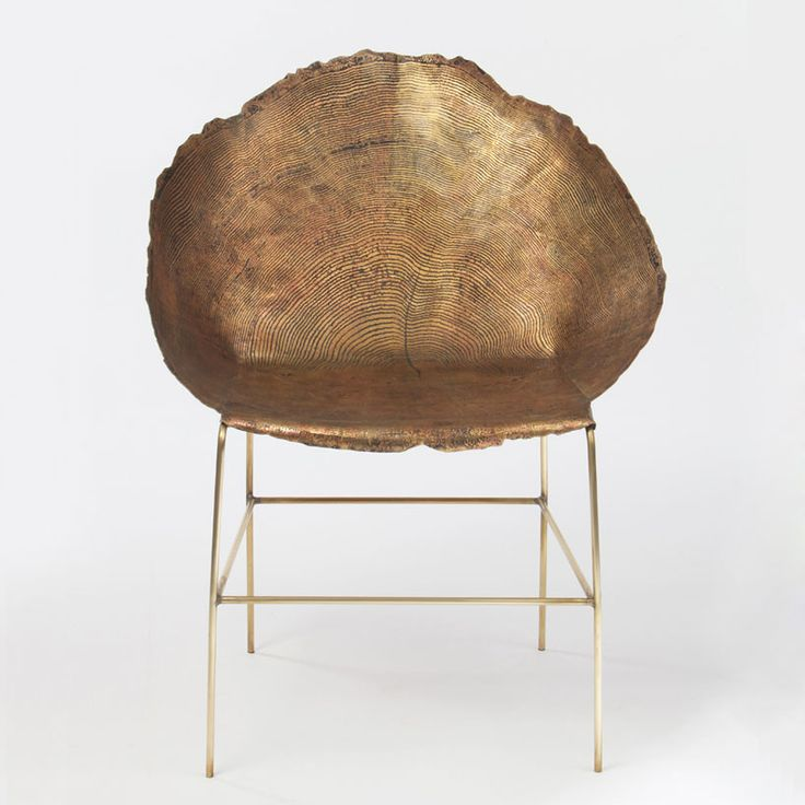 the designer etches tree ring patterns into her metal furniture pieces expressing the history and beauty of nature