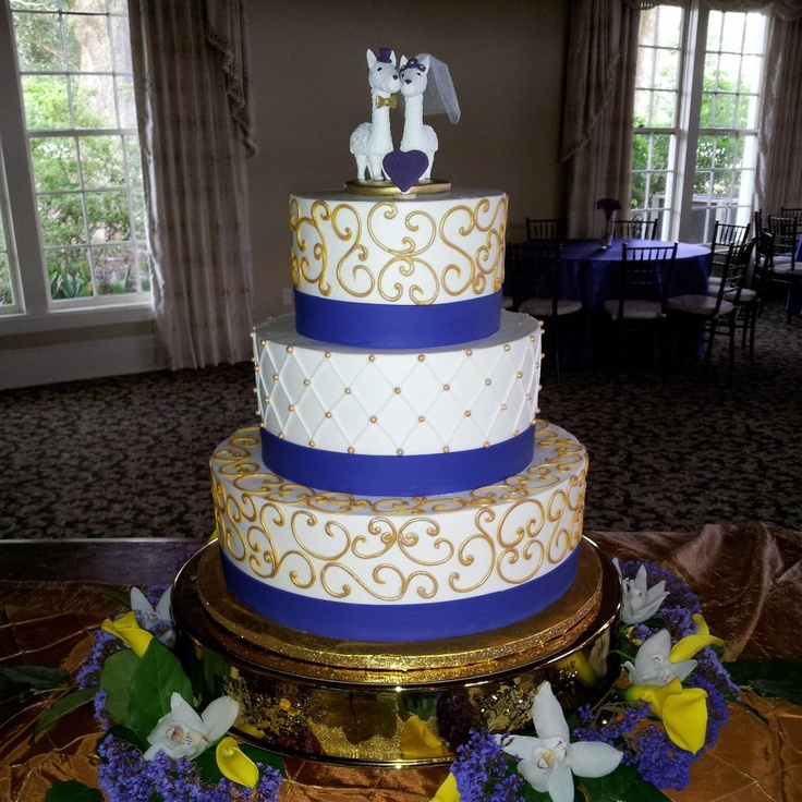 My purple and gold LSU wedding cake with a bride and groom llama cake topper! @Matty Chuah Ambrosia Bakery