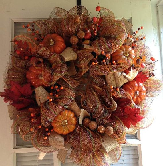 Please enter coupon code AUTUMN10 at check out for 10% off!!!    This beautiful, fall wreath was created using an 18 inch faux, evergreen wreath