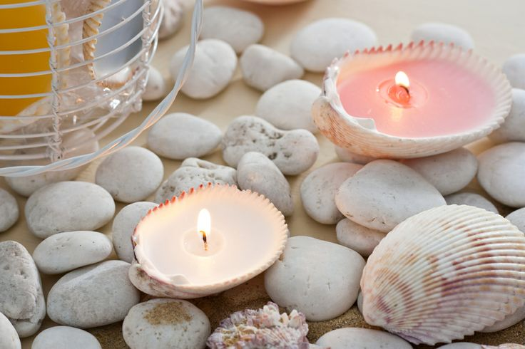"""Sea Shell Votives-A white wire basket filled sea shell votives makes a thoughtful gift. Includes an assortment of 12 genuine shells, each approx. 2.5 x 3""""."""