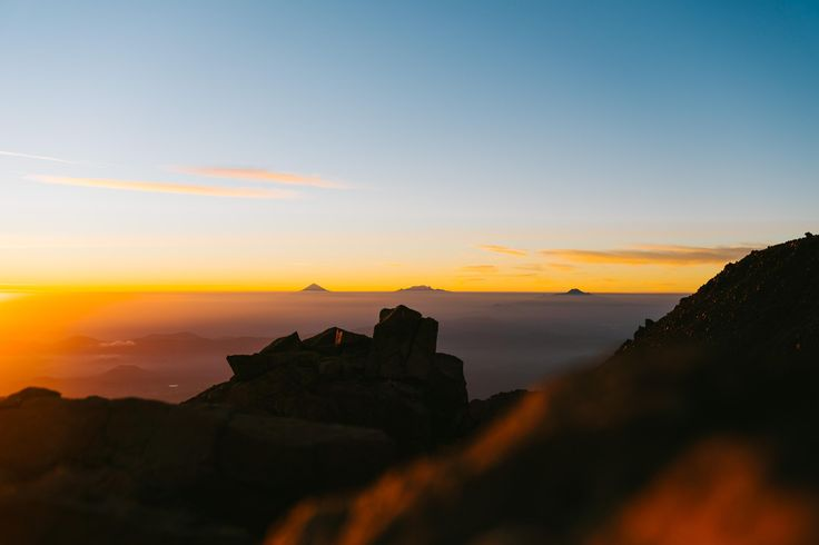 Volcanoes Popocatépetl Iztaccihuatl and La Malinche rising above the clouds at sunset. [OC] [3000  2001] http://ift.tt/2AawNJJ