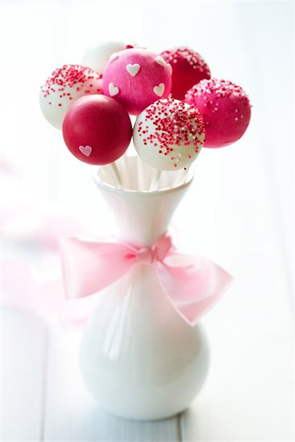 Add a bit of fun to your wedding by creating or ordering a collection of vibrant pink wedding cake pops