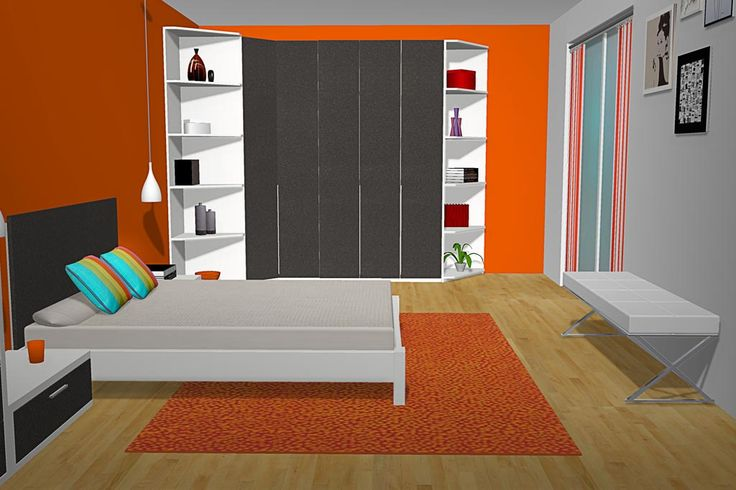Nos encontramos de este dormitorio de matrimonio cuando entramos por la puerta pues el color que más destaca es el naranja ya que tenemos algunas paredes pintadas en este color también con unas cortinas rayadas en blanco y naranja junto con la alfombra.