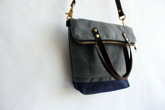 *Fold-over purse that can be worn cross body or carried by its handles *Made from handsomely rugged waxed canvas fabric *Water resistant *Lined