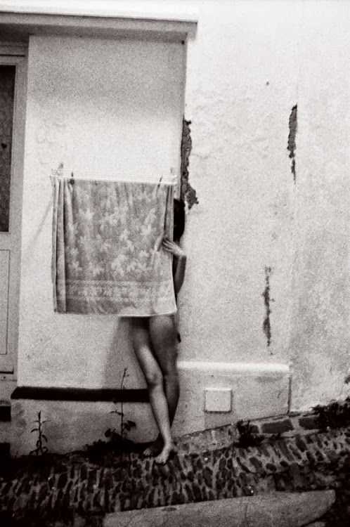 Despite the initial boldness of many of Francesca Woodman's self-portraits, she simultaneously hides much from the camera. Her face may be blurred or cropped out or she may even turn her back to her audience. And then there's a suggestion of some ongoing story ...