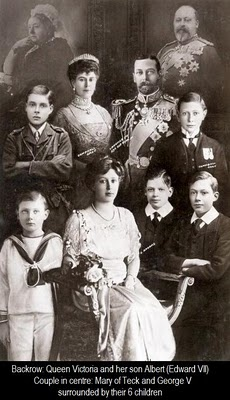 King George V and Queen Mary of England with their family. At the top left is Queen Victoria, grandmother of George V, and top right is King Edward VII, father of George V.