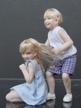 Susan Scogin. I love Susan's work. her children are always in very realistic poses, just being kids.
