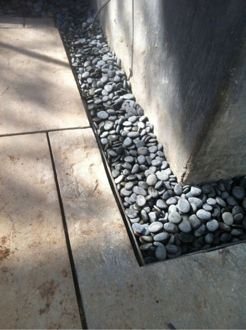 Design detail of the day! Mexican pebbles gutter around the stone patio.