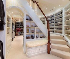 Dream closet! I wait live in there... Maybe that's why we don't design a house around the closet after all.