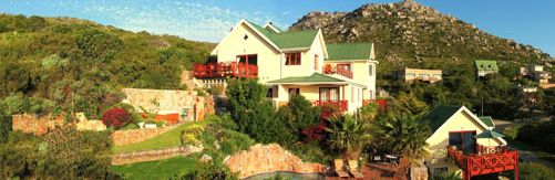 DUNVEGAN LODGE, Clovelly, Cape Town - Wonderfully positioned guesthouse set high up on the mountainside with sweeping views across the golf course, Fish Hoek valley and the distant Atlantic Ocean. All bedrooms with private patios and views.