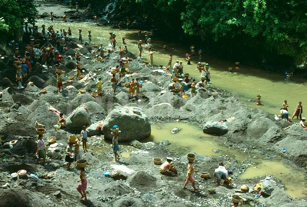 Villagers washing clothes in a river, southern Bali, 1979..