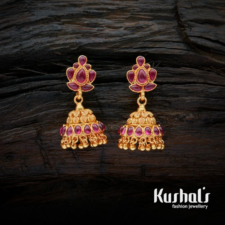 A pretty pair of jhumka adorned with Ruby stones studded with Spinal Stones. Crafted using South Indian Traditional Silver temple jewellery the entire piece is crafted in Pure Silver (92.5).