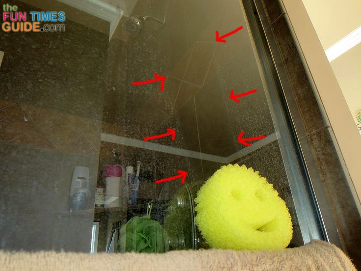 As you can see, a dry Scrub Daddy sponge removes soap scum from glass shower doors effortlessly - just one long swipe! photo by Lynnette at TheFunTimesGuide.com