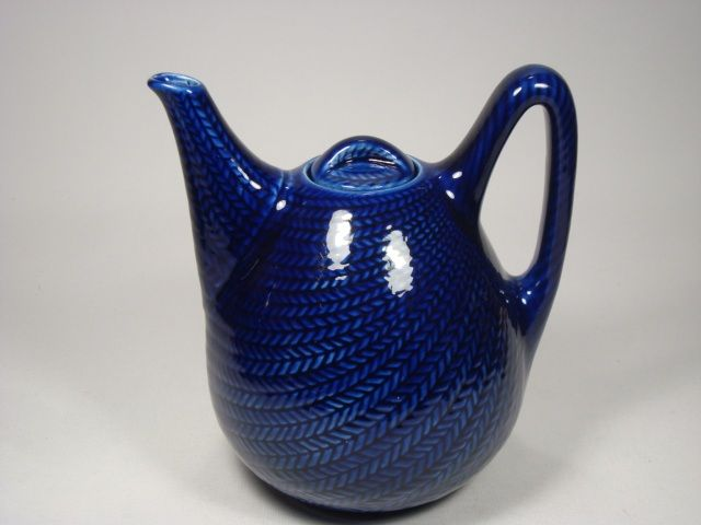 "Blå Eld by Hertha Bengtson for Rörstrand  The Blå eld - Blue fire - range was designed by Hertha Bengtson and produced by Rörstrand between 1949 and 1971. It has become a classic design icon, not only in Scandinavia but all over the world.  Tea pot. Height: 18,5 cm (7.3"") Weight: 0,65 kg (1.4 lbs)"