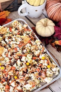 Turkey Munch - Fall Popcorn Snack Mix with bugles, reeses pieces and sprinkles all drizzled in white chocolate and pumpkin candy melts.  Recipe at Tidymom.net