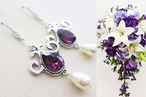 Genuine Swarovski pear drop pearl and crystal these bridal earrings finished off Sterling silver cubic zirconia pave ear wire  Measurement* The earrings are about 2.5 long  Matching Necklace https://www.etsy.com/listing/526465768/purple-bridesmaid-necklace-swarovski?ga_order=date_desc&ga_search_type=all&ga_view_type=gallery&ga_search_query=purple%20bridesmaid%20necklace&ref=sr_gallery_11 ...............................  Swarovski Elements crystal pearls are the only simulated pearls in the…