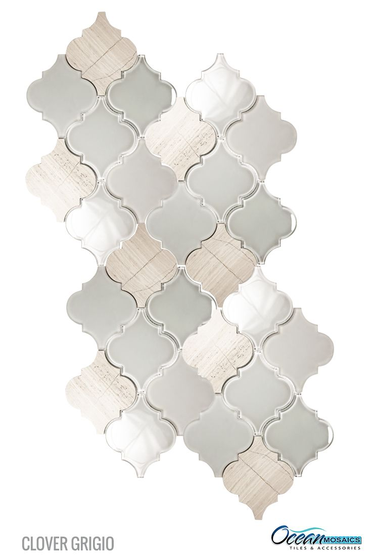 Beveled clear frosted glass combined with natural stone, makes an attractive kitchen backsplash with an arabesque moroccan flair. Clover Arabesque Grigio Mosaic Glass Tile.