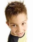 Spiky hairstyle for little boys. hair cut with deep razor strokes. More haircuts for boys: http://www.hairfinder.com/kidshairstyles/hairstyles_for_boys.htm